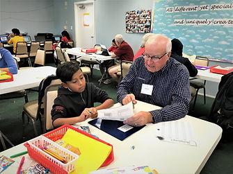 Mr. Steve is helping Jorge on math homew