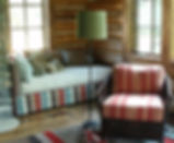 RUSTIC WESTERN INTERIOR DESIGN FOR LOG HOME LIVING IN JACKSON, WY. CUSTOM FURNISHINGS AND PILLOWS AND WINDOW TREATMENTS  MADE BY CADENET DESIGN.  WOVEN LEATHER CHAIR AND CUSTOM CUSHIONS.  FABRIC COMPANIES ARE SCHUMACHER, ANDREW MARTIN, CLASSIC CLOTH, ETC.