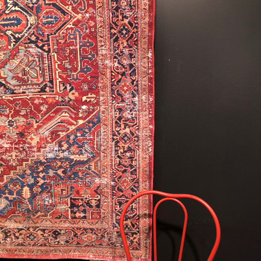 darling vignette of red chair/hanging rug~