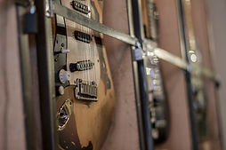 Close up of left handed Fender Stratocaster with professional relic work
