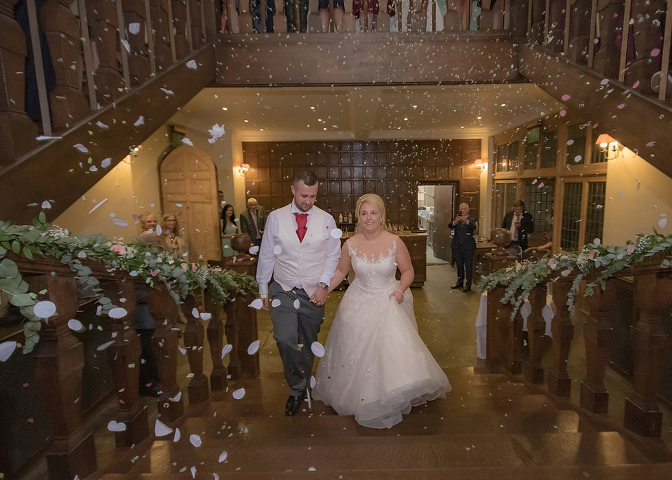 Wedding confetti on the grand staircase at Layer Marney Tower - Essex Wedding Venue