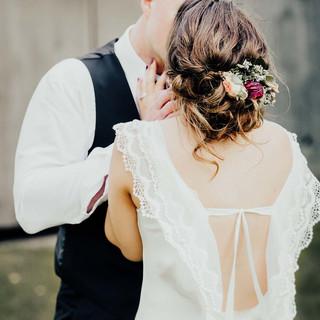 Wedding hair updo with flower hair piece