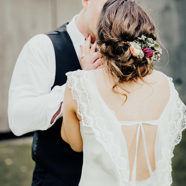 Wedding hair updo with flower hair piece