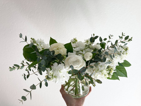 White and green sympathy flowers