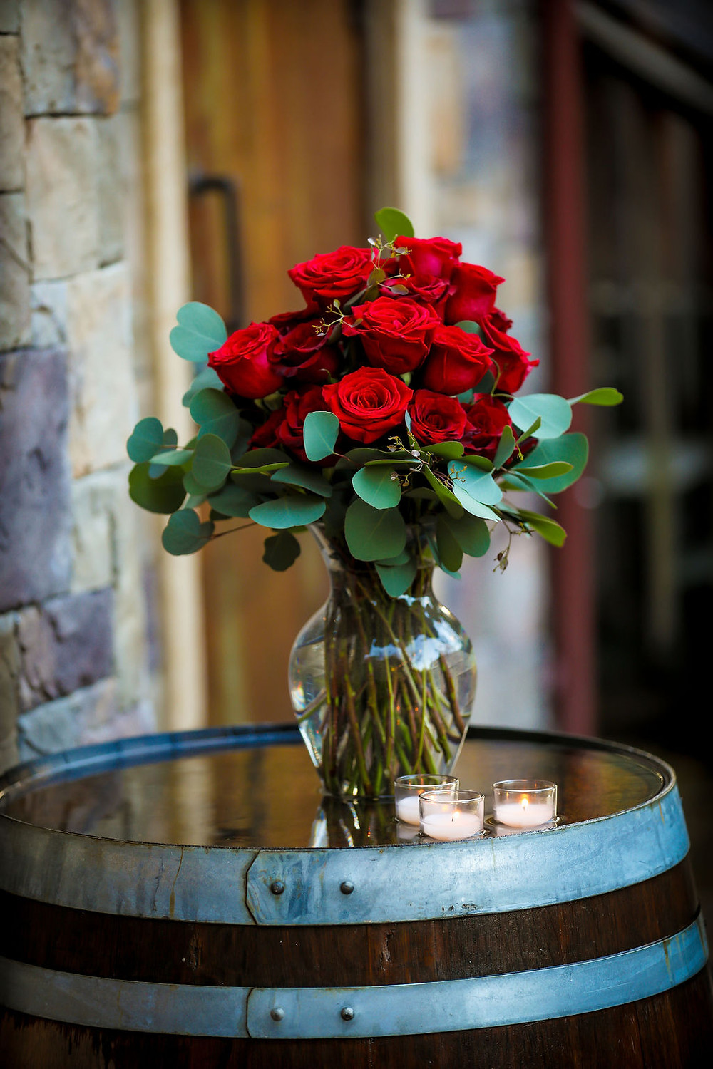 Red Rose Bouquet on a wine barrel and Vezer Family Vineyard Cottage