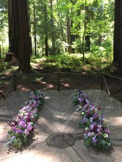 Purple Proposal Aisle Flowers