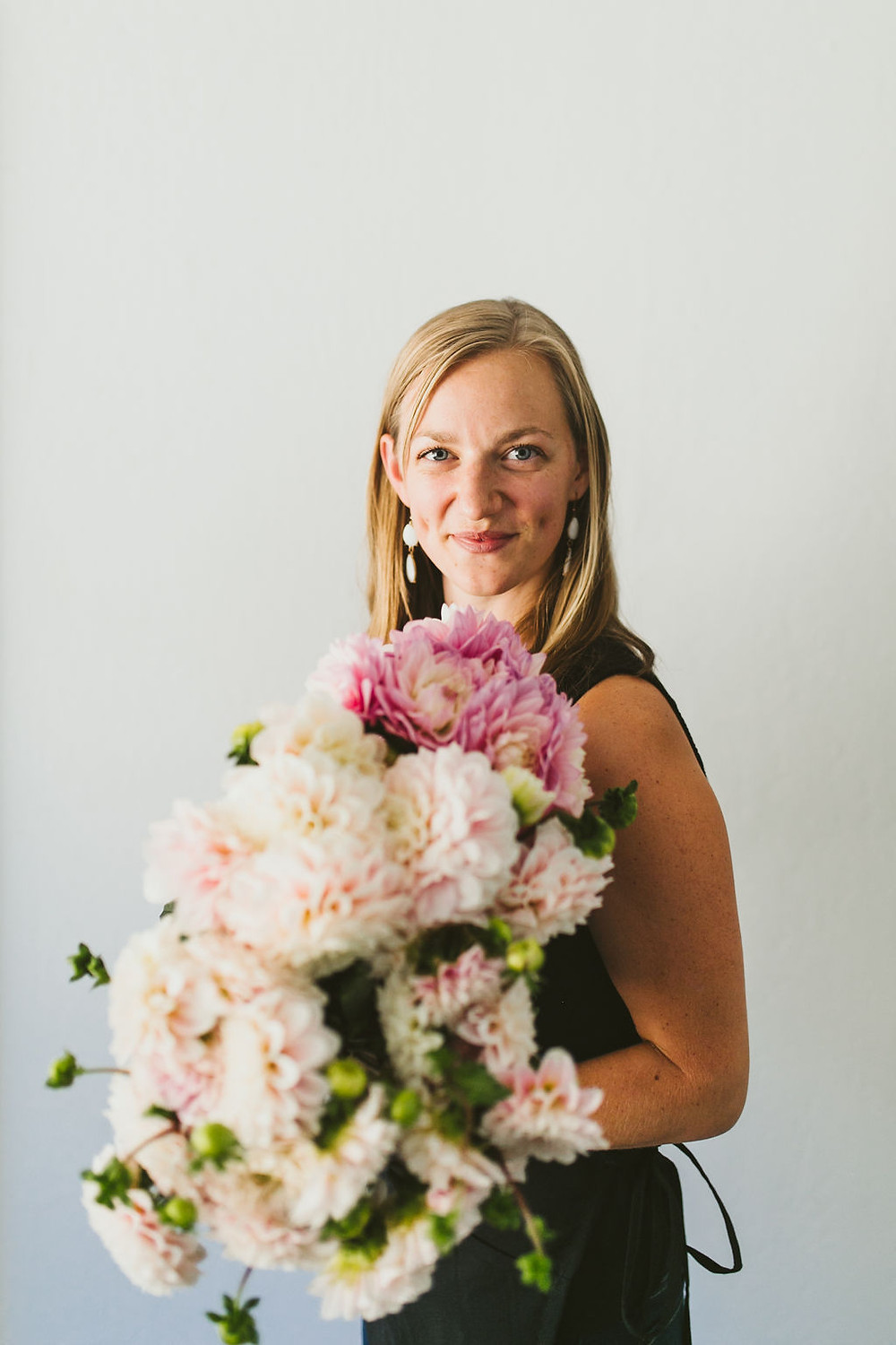 Bay Area floral designer with blush and pink dahlias