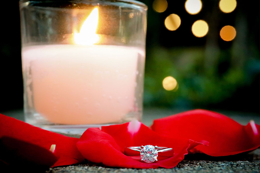Votive candles with engagement ring and red rose petal at Vezer Family Vineyard Cottage