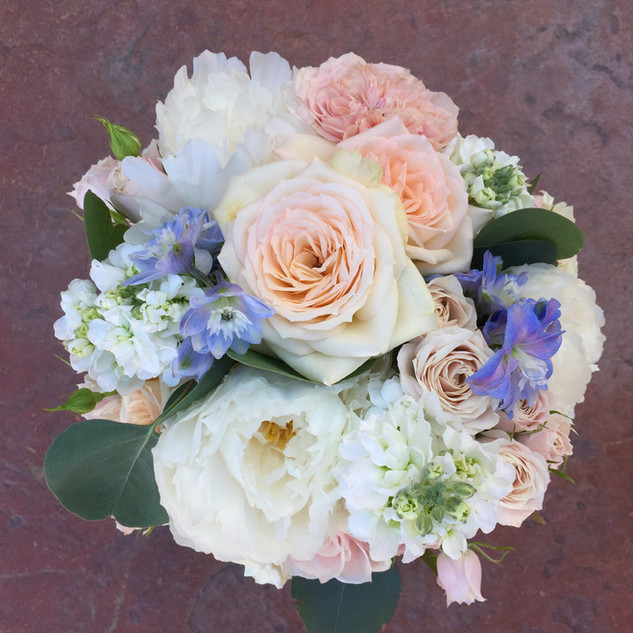 Soft bridal bouquet with pink, peach, wh