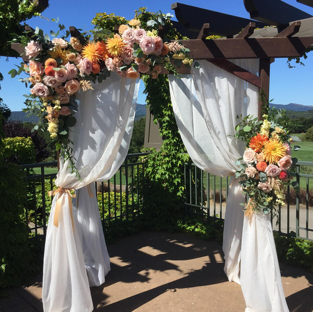 Colorful wedding arch flowers