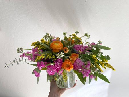 Bright pink, yellow, and orange arrangem