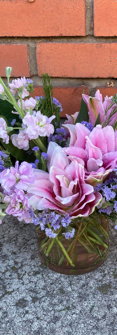 Pink and purple sympathy bouquet
