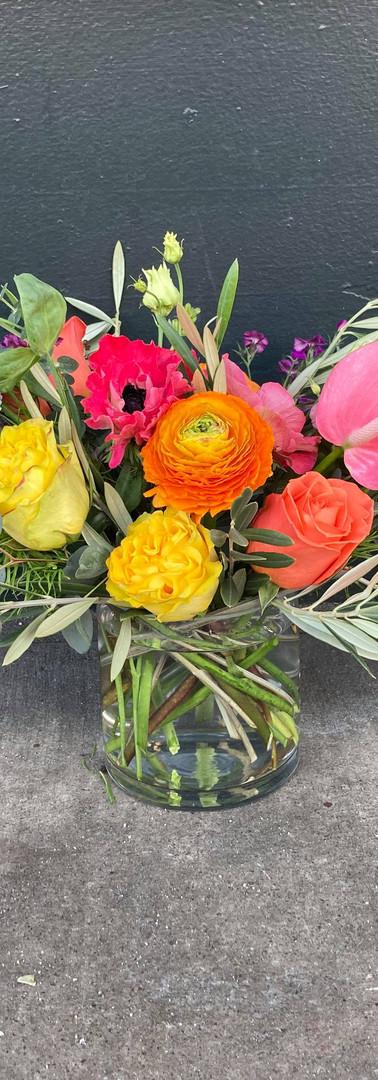 Bright and cheery rainbow arrangement