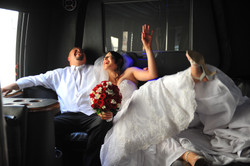 bride and groom laughing in limo