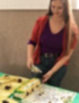 Student Cutting 20th anniversary cake -