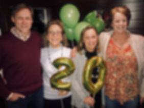 Celebrating 20 years staff photo with ba
