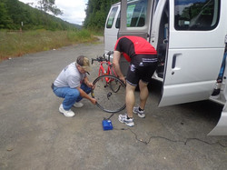Repairing a flat along the bike route on day 1