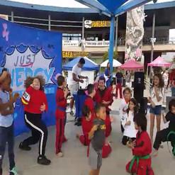 Just Energy Entertainment brings kids up for the Ultamate Hokey Pokie Air Guitar Dance off