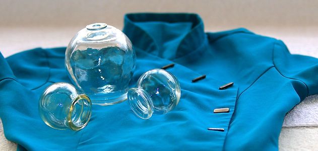 Glass cupping bowls on Chinese practitioner's tunic