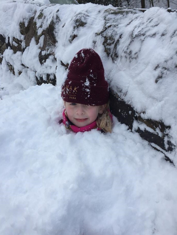 child playing in the snow, language development