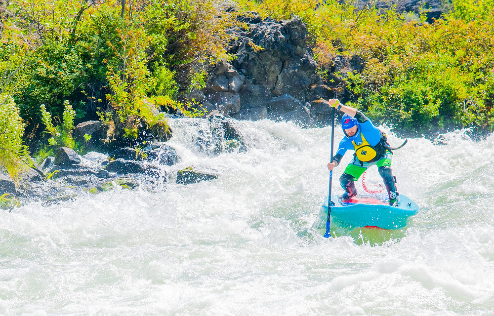 Whitewater SUP paddle boarding withb Paul Clark on theb Deschutes River