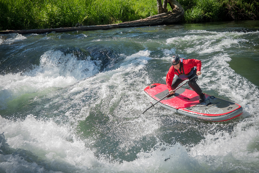Dan Gavere whitewater paddle boarding on the White Salmon River. Photo, Paul Clark/SUPPAUL