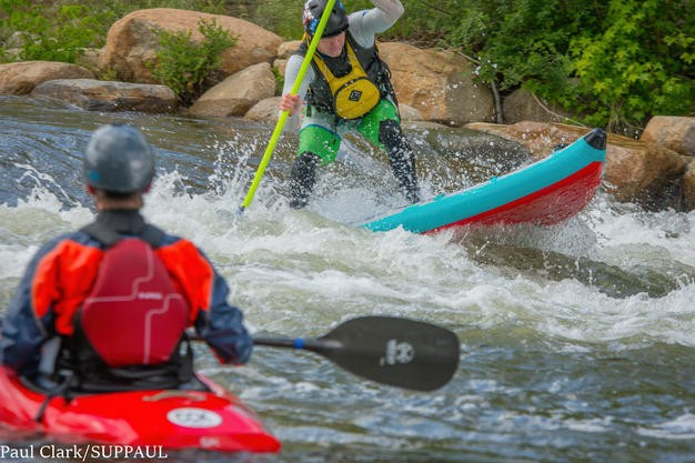 Whitewater paddle boarding wearing S.H.I.P.P.S (shoes, helmet, insulation, PFD, Padding,and signalling device