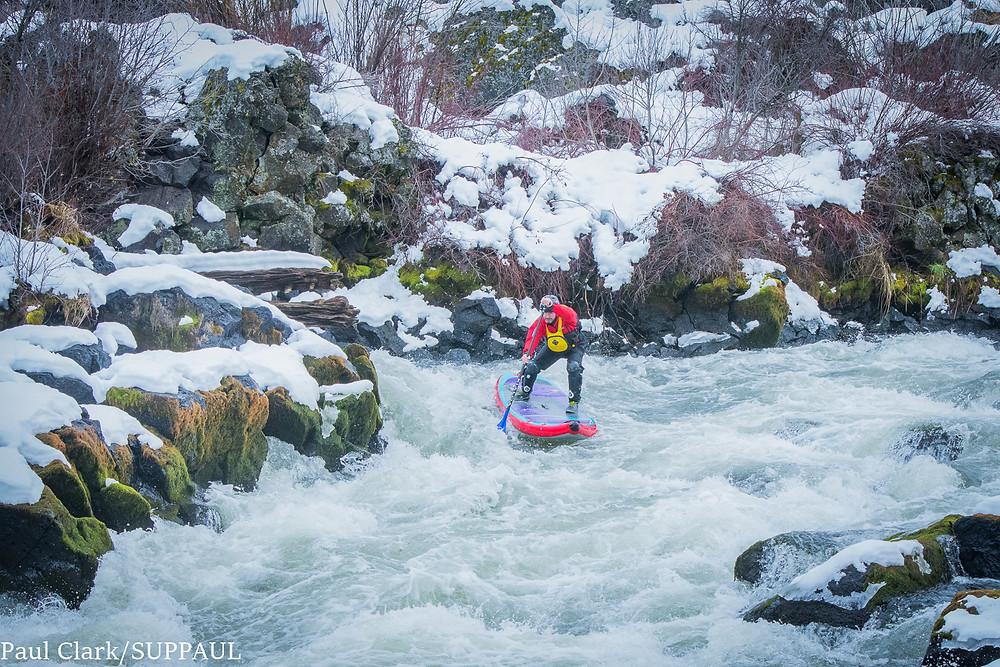 Paul Clark paddle boarding Big Eddy rapids. Bend, Oregon. SUPPAUL photography