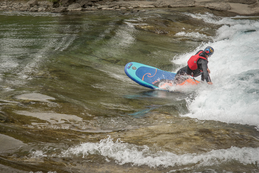 River SUP Surfing in Patagonia wetsuit. Paul Clark SUPPAUL