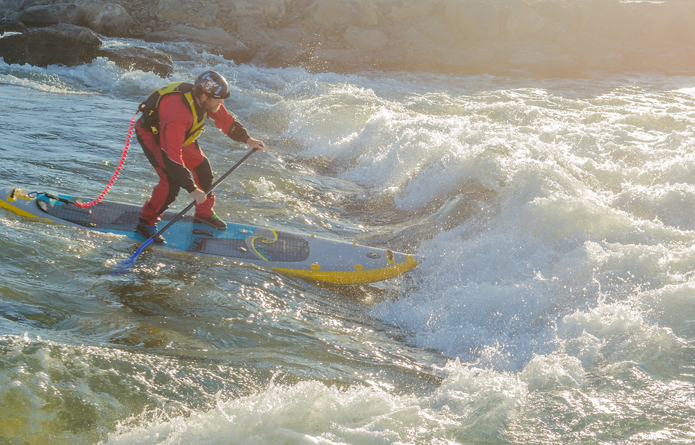 Paul Clark, showing what to wear whitewater paddle boarding.