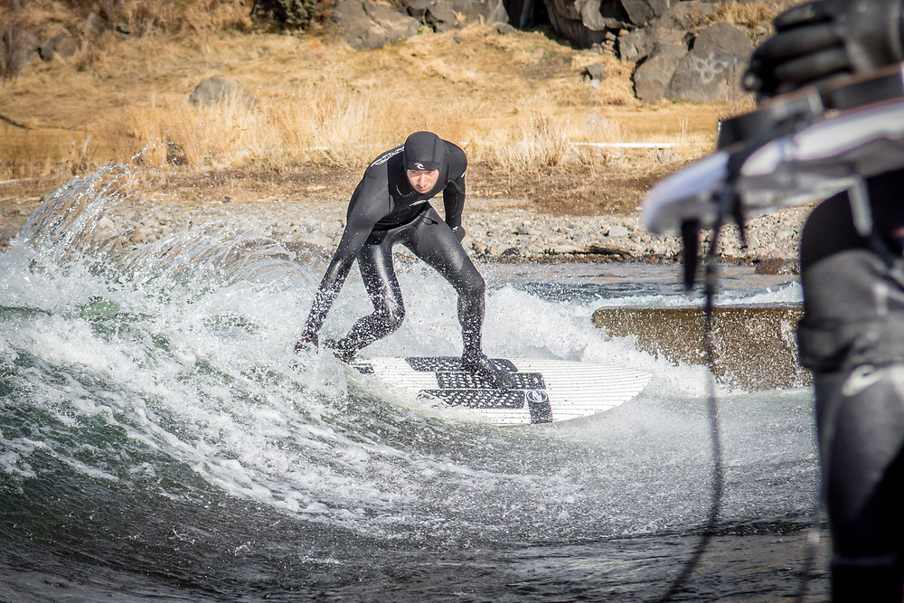 River Surfing Bend whitewater park with wetsuit. By Paul Clark SUPPAUL
