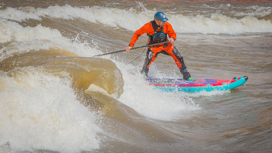 River surfing in a drysuit by Paul Clark SUPPAUL