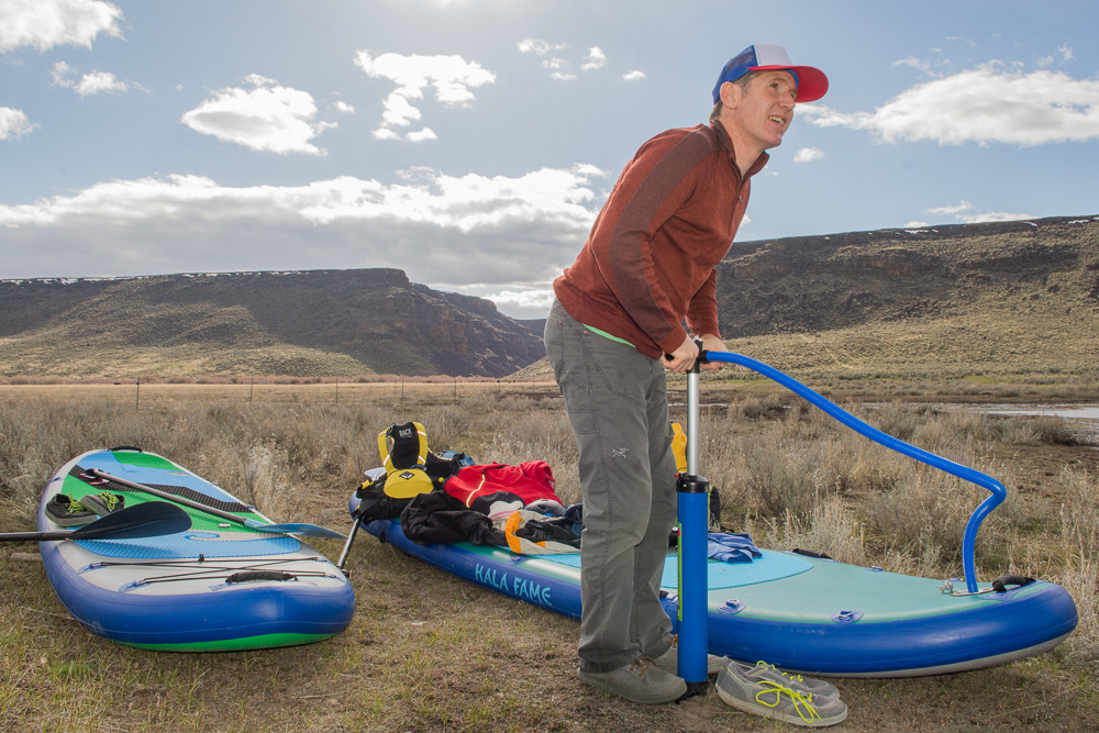 Paul Clark inflating paddle boards on the John Day River