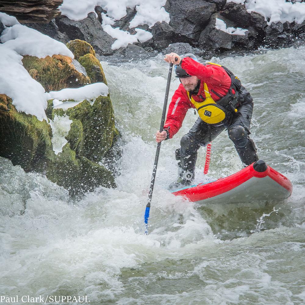 Paul Clark paddle boarding Big Eddy rapids in Bend, Oregon. SUPPAUL photography