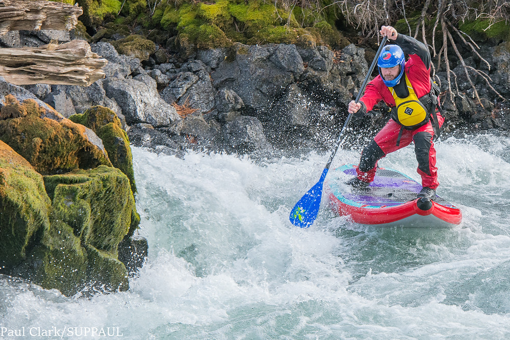 whitewater sup: Paul Clark wearing the Stohlquist AMP drysuit