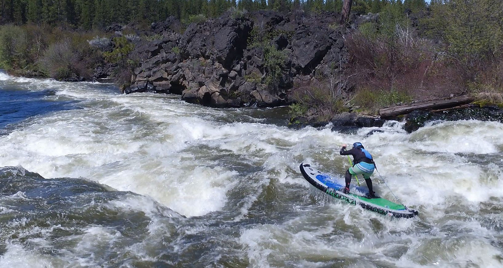 Paul Clark SUPPAUL whitewater paddle boarding Big Eddy rapids in Bend, Oregon.