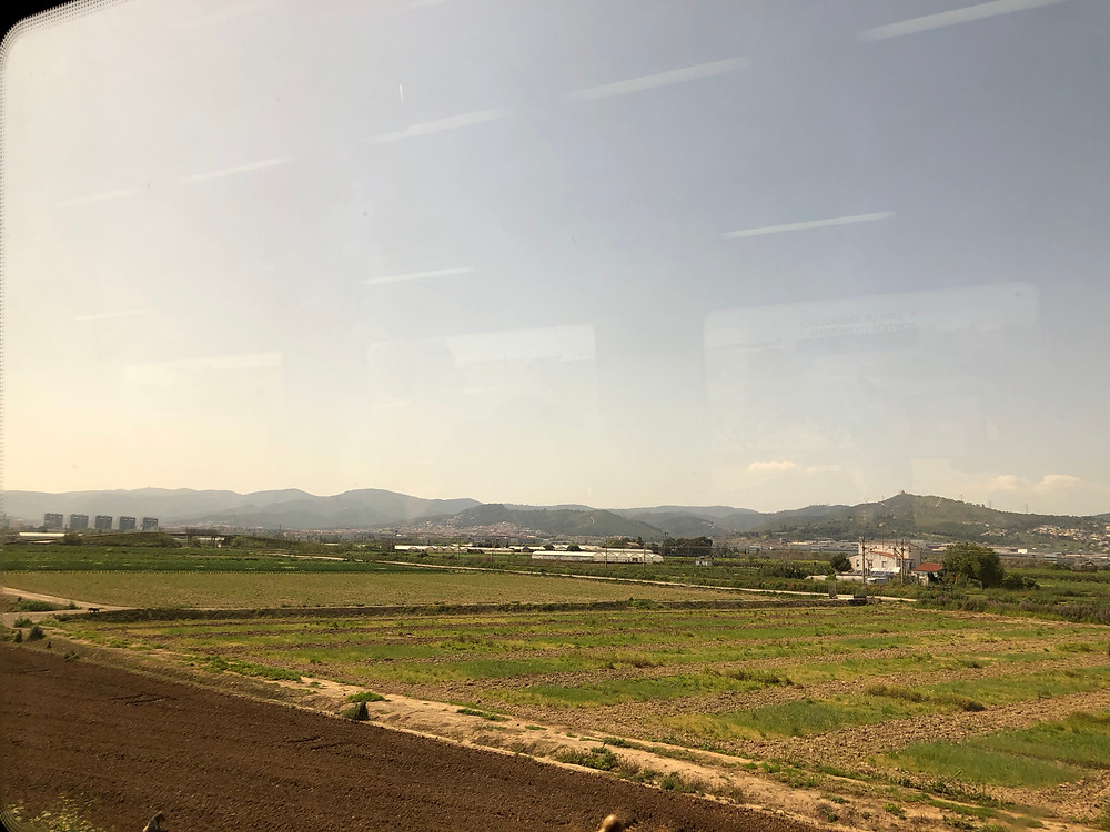 View of the country side from the train traveling to Barcelona, Spain.