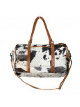 Onyx hair on leather travelling bag