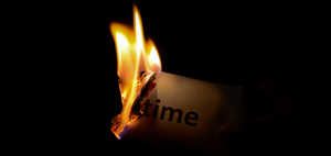 "Burning a piece of paper that says ""time."""