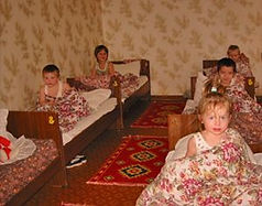 girls in cots orphanage.jpg