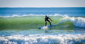 Surfing on Assateague Island in the Winter
