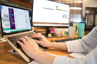 Typing on a lapton in a marketing workplace setting