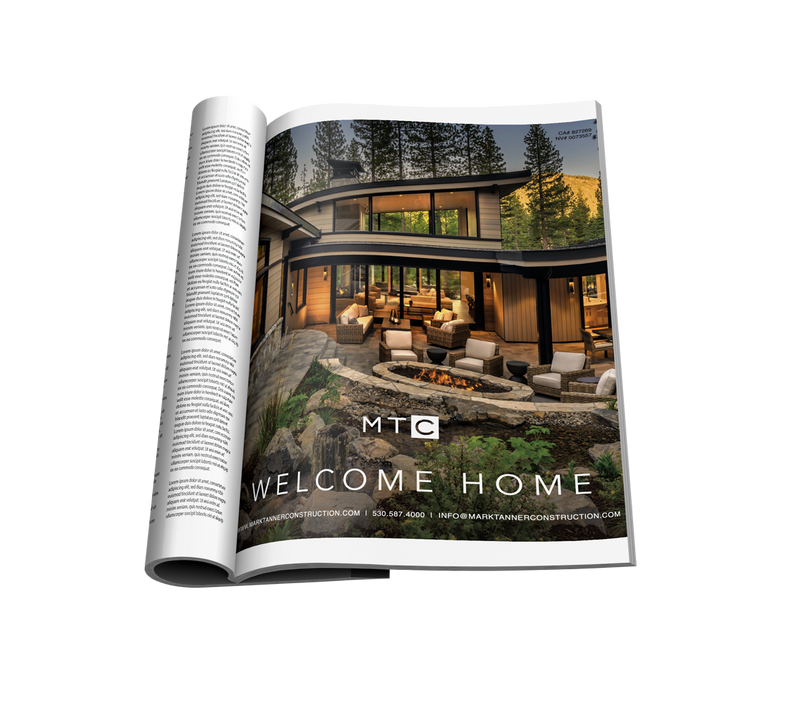 Folded magazine with exterior of modern home in pine trees
