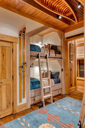 Interior design of a childs bedroom, bunkbed with canoe on ceiling