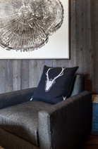 Interior deisgn area of a home with a chair and a wall print