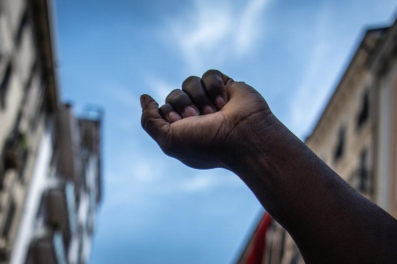 The raised fist. A black man raises his