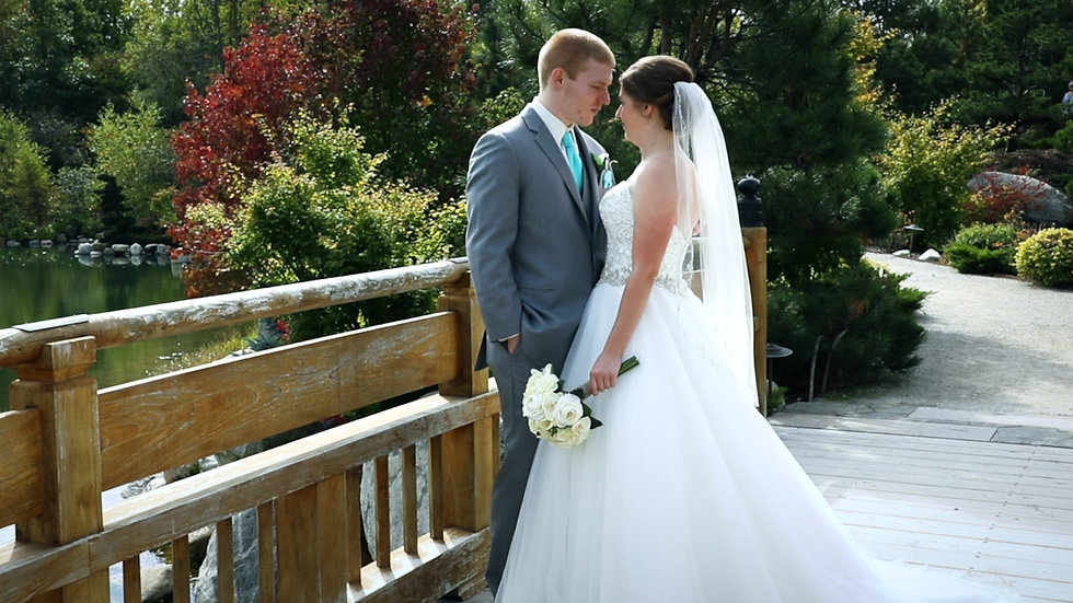 Ashley and Quinn stand together on a bridge in Frederik Meijer Gardens & Sculpture Park