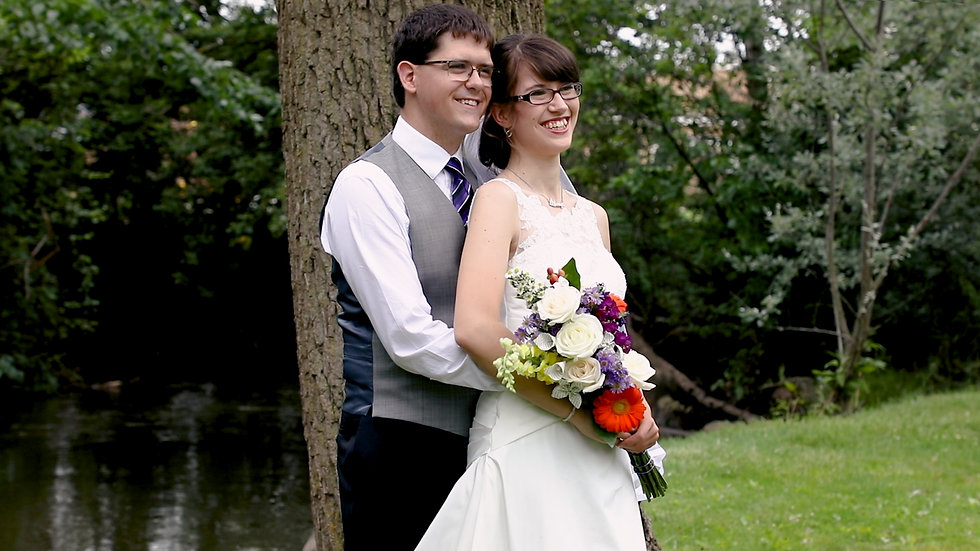 Andi and Aaron embrace each other as they take their wedding portraits at Wedgewood Park