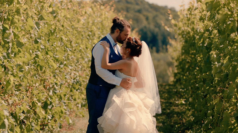 Ryan kisses Evangeline on the forehead as they dance together in the vineyard of 45 North Winery
