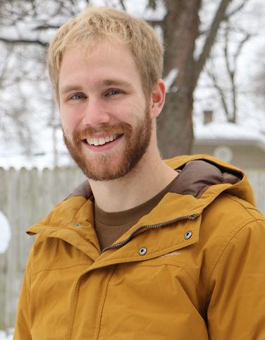 Medium length shot of Jesse outside in his winter coat